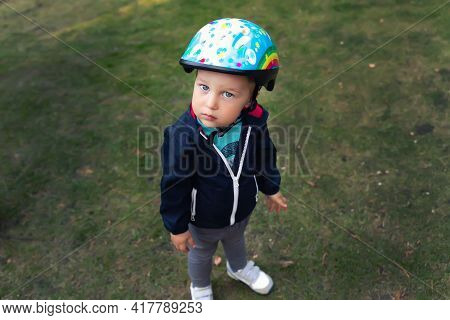 Cute Little Adorable Caucasian Happy Toddler In Safety Helmet Ask Looking Going To Have Fun Riding K