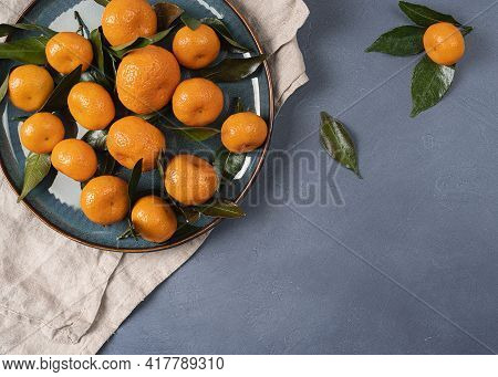 Served Plate With Tangerines (oranges) With Copy Space, Ripe Tangerines With Leaves Serving Linen Co