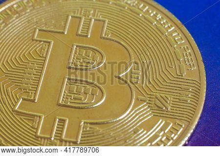 Close Up Of A Physical Version Of Bitcoin Btc .stock Market Concept. Btc