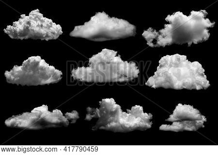 Separate White Clouds On A Black Background Have Real Clouds. White Cloud Isolated On A Black Backgr