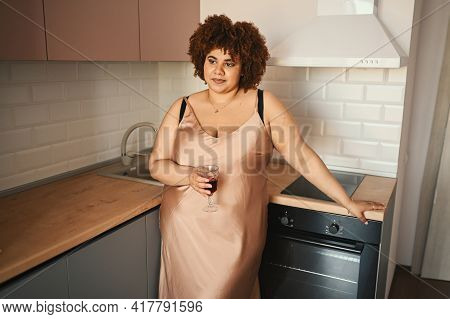 Beautiful Curvy Plus Size African Black Woman Afro Hair Drinking Red Wine On Modern Scandinavian Sty