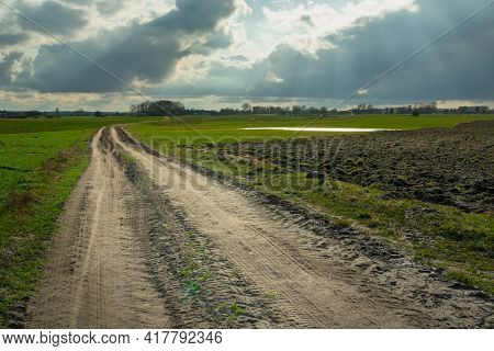 Rural Road Through Fields And Sunbeams On The Sky, Czulczyce, Lubelskie, Poland