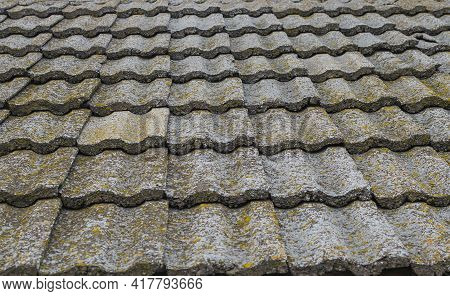 Old Stone Roof Tiles Texture. Obsolete Roof Covering Buildings. Old European Architecture.