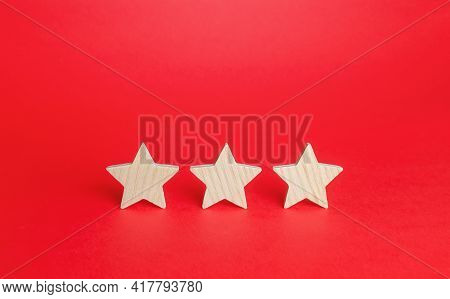 Three Stars On A Red Background. Rating Evaluation Concept. Service Quality. Buyer Feedback. High Sa