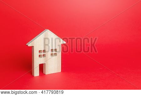 Wooden Figurine Of A Residential Building. Minimalism. Affordable Housing. Rent Of Real Estate. Cons