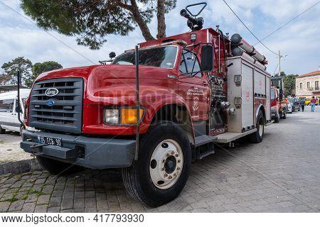 Seferihisar, Izmir, Turkey - 03.09.2021: Front View Of Red Modern Fire Brigade Truck Parked In Front