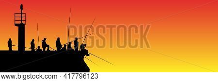 Silhouettes Of Fishermen With Fishing Rods On Pier With Lighthouse Against The Sunset. Lots Of Peopl
