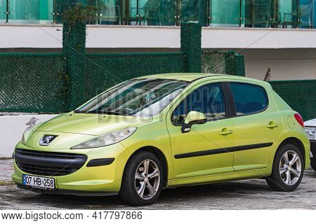 Alanya, Turkey - April 12 2021: Green Peugeot 208  Is Parked  On The Street On A Warm Summer Day Aga