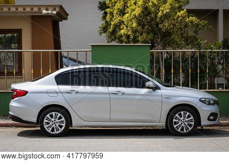 Alanya, Turkey - April 12 2021: Silver Fiat Albea  Is Parked  On The Street On A Warm Summer Day Aga