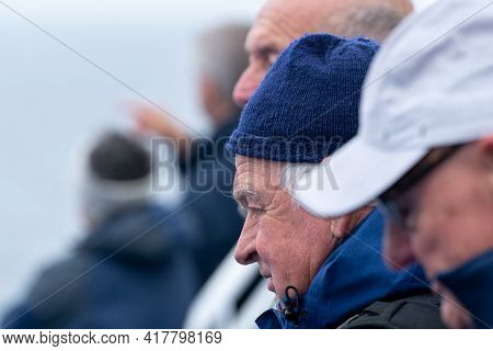 Hirsthals, Denmark - 05.20.2017: Tough Northern Elders Watching The Sea From The Deck Of A Cruising