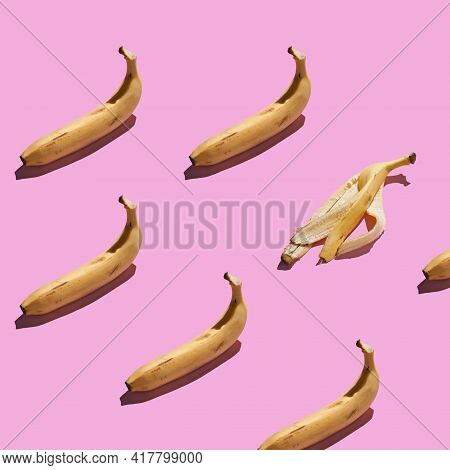 Colorful Pattern Of Fresh Yellow Bananas On Pink Background. Tropical Abstract Background.banana, Ba