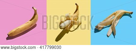 Colorful Pattern Of Fresh Yellow Bananas On Pink Yellow Blue Background. Tropical Abstract Backgroun