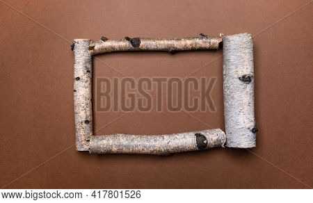 Bright Natural Brown Background With Frame Of Birch Trunk Parts And Copy Space For Text Inside It. C