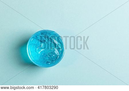 Cosmetic Liquid Gel Serum Lubricant Hyaluronic Acid With Oxygen Bubbles On A Blue Background. Hair,