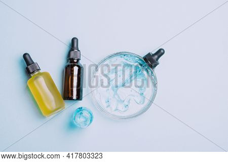 Cosmetics Liquid Gel Serum Lubricant Hyaluronic Acid With Oxygen Bubbles In Various Vials Of Glass L