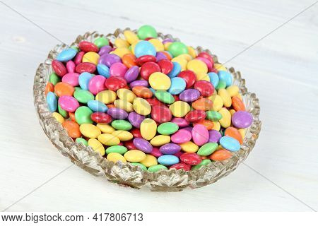 Bowl Ull Of Colorful And Sweet Smarties. Chocolate Buttons In Colors Of Rainbow.  Delicious Candies