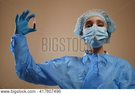 A Nurse Holds A Test Tube With A Coronavirus Positive Blood Sample From Wuhan, China. 2019 Ncov Pand