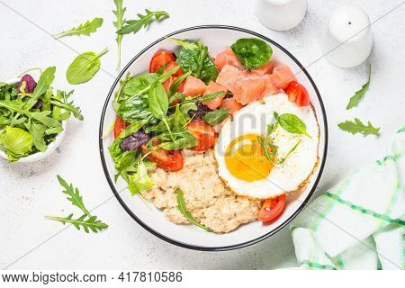 Savory Breakfast With Oatmeal, Salmon And Salad.