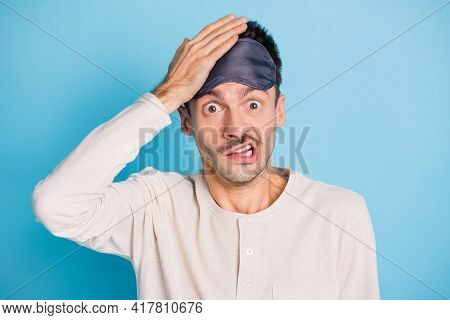 Portrait Of Nice Funny Puzzled Guy Wearing Sleep Mask Oops Mistake Reaction Isolated Over Bright Blu
