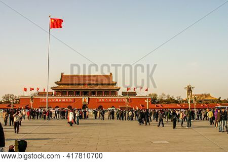 Beijing, China, March 12, 2006:  Red Flags Flying In The Wind At The Historic Tiananmen Square In Be