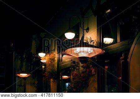 Terrace Outdoor Heater Pendant And Round Lanterns Lighting Illuminate The Night Backyard With Decora