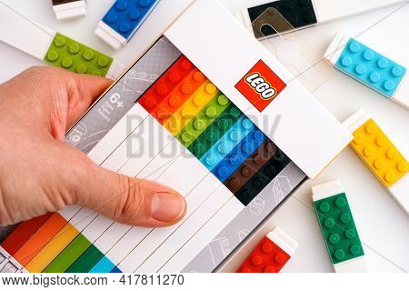 Tambov, Russian Federation - November 18, 2020 Lego Box With Colour Gel Pens In Woman Hand.