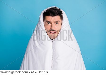 Photo Portrait Of Astonished Disgusted Guy Wrapped In Duvet Isolated On Vivid Blue Colored Backgroun