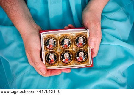 Tambov, Russian Federation - February 14, 2020 Woman Hands Holding Open Box Of Mozart Candies. Turqu