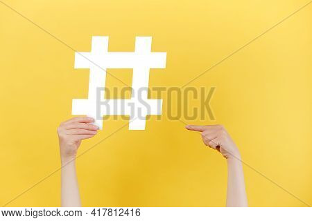 Horizontal Images Of Female Hands Holding And Pointing On Large Big Hashtag Sign, Viral Web Content,