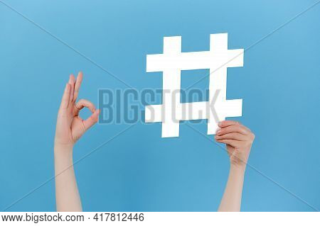Unrecognizable Young Female Holding Large Big Hashtag Sign And Showing Okay Gesture, Viral Web Conte