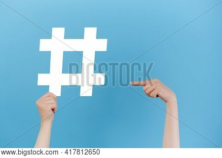 Horizontal Images Of Female Hands Holding Large Big White Hashtag Sign, Viral Web Content, Internet