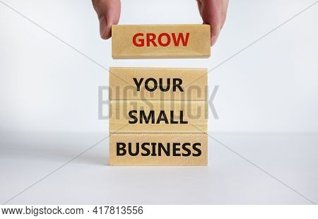 Grow Your Small Business Symbol. Words 'grow Your Small Business' On Wooden Blocks. Businessman Hand