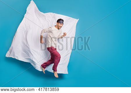 Full Length Photo Side Profile Portrait Of Running Guy Jumping Up Isolated On Vivid Blue Colored Bac