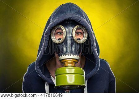 Woman Wearing A Respiratory Mask Against A Yellow Illuminated Background