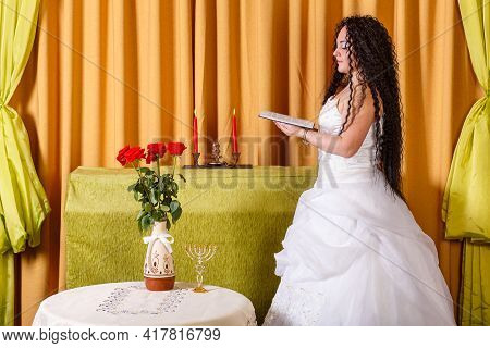A Jewish Bride In A White Wedding Dress Without A Veil Reads The Tegilim Prayers Before The Chupa Ce