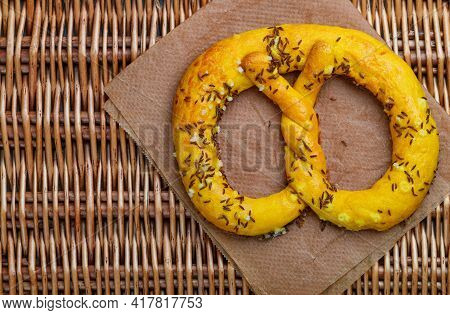 Freshly Baked Homemade Pretzel With Cumin Or Caraway Seeds And Coarse Sea Salt. German (bavarian) Be