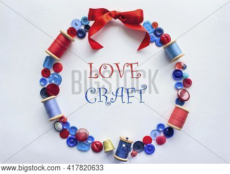 The Wreath Is Made Of Buttons And Threads Of Red And Blue Colors With Pins And A Bright Bow Of Satin