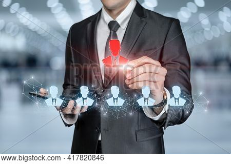 Business Man Chooses Employee From Human Resources On Blurred Background.
