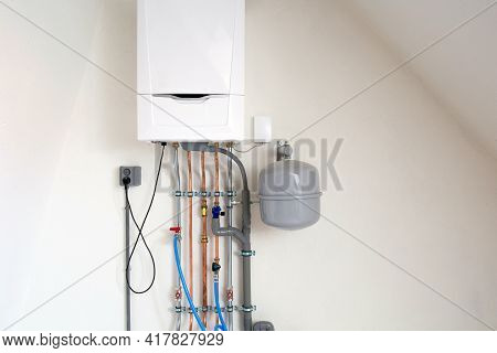 New Gas Boiler, Heating System With Copper Pipes, Valves And Other Equipment In A Boiler Room Gas He