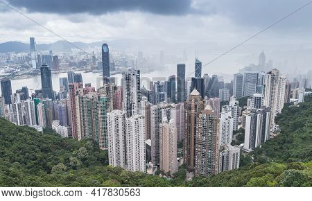 Hong Kong Skyline, Aerial City View Taken From Victoria Peak Viewpoint In A Cloudy Day