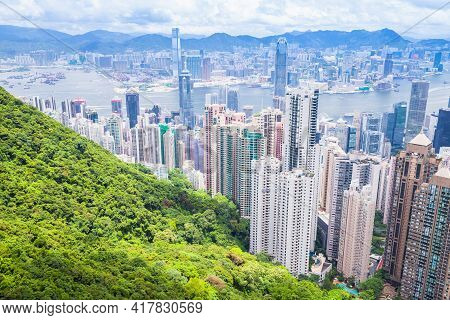 Hong Kong City Skyline, Aerial View Taken From Victoria Peak Viewpoint In A Sunny Summer Day