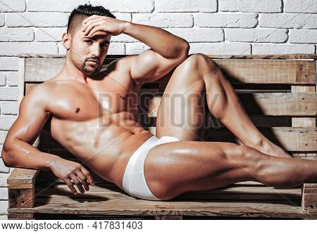 Sexy Muscular Men With Bare Naked Body Torso In Underpants On Wooden Pallet Sofa.