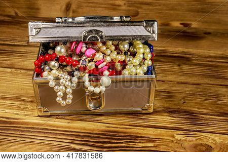 Jewelry Box Full Of Jewelry And Accessories On Wooden Background