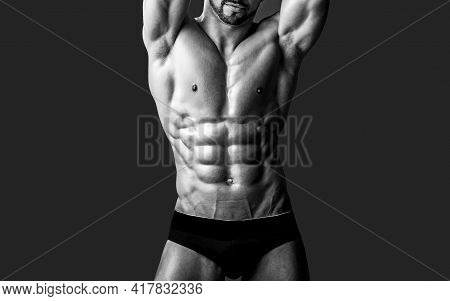 Naked Male Body In Pants Posing With Bare Chest On Black. Sexy Muscular Men With Bare Naked Body Tor