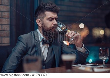 Man In Cafe Drinking Alcohol. Bearded Man Rest In Restaurant With Wine Glass. Perfect Wine. Alone Hi