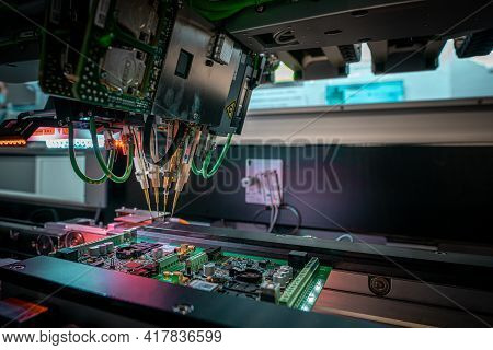 Automatic Machine For Diagnostics Of Electronic Boards, Production. Small Needles Are Checking The E