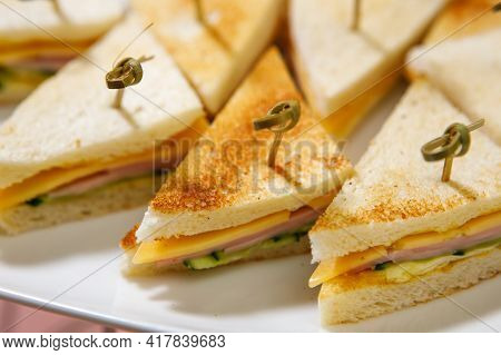 A Plate Of Sandwiches With A Crispy Toasted Crust On Wooden Skewers. Fast Food Concept.