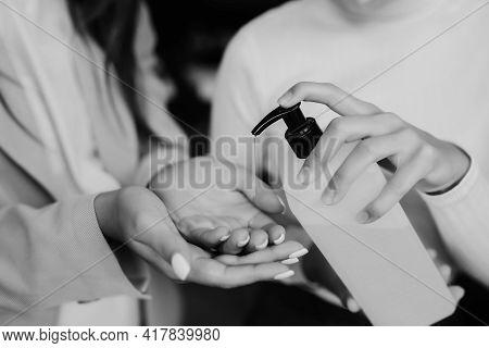 Female Hands Applying Antibacterial Liquid Soap Close Up.