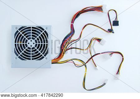 Power Supply Unit With Wires For A Personal Computer Close-up On A White Background.