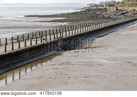 Weston-super-mare, Uk - April 20, 2021: The Marine Lake Causeway After The Lake Had Been Drained As